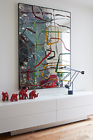 The white walls throughout the house allow the colourful artwork space to breath without the home turning into a gallery