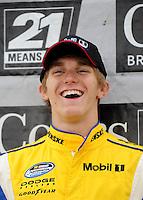 Oct. 3, 2009; Kansas City, KS, USA; NASCAR Nationwide Series driver Parker Kligerman after winning the pole position for the Kansas Lottery 300 at Kansas Speedway. Mandatory Credit: Mark J. Rebilas-