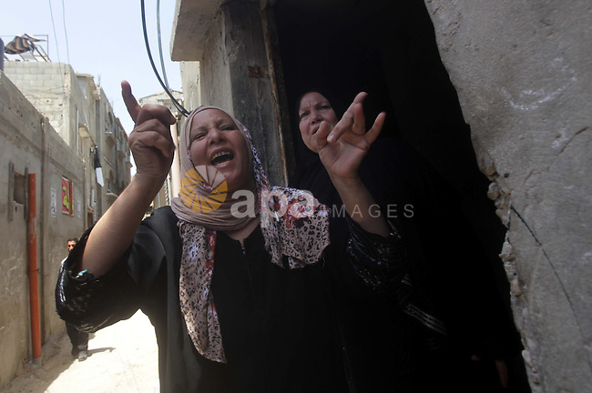 Palestinian relatives of Haitham Mishal, 29, react during his funeral in the Shati Refugee Camp in Gaza City, Tuesday, April 30, 2013. An Israeli aircraft attacked a motorcyclist in Gaza on Tuesday, killing the rider and wounding two other people in the first deadly airstrike in the Palestinian territory since a truce was reached with Palestinian militants last November. The Israeli military said the airstrike killed Haitham Mishal, whom it identified as a militant involved in the April 17 rocket attack on the southern Israeli resort town of Eilat. Photo by Ashraf Amra