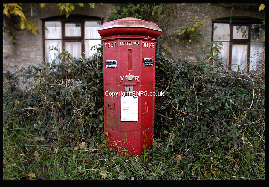BNPS.co.uk (01202) 558833<br /> Picture: LauraJones/BNPS<br /> <br /> Before the tidy up and lick of paint...<br /> <br /> Red letter day for England's oldest post box as it once again becomes the pillar of the community...<br /> <br /> England's oldest postbox in Holwell, Dorset.<br /> <br /> The oldest post box in England has had its red letter day after being spruced up with a new lick of paint and returned to its former glory.<br /> <br /> The iconic box was built in 1855 and is an unusual 'Butt' type design, which means it is an octagonal shape instead of cylindrical.<br /> <br /> It also has a vertical slot for letters to be dropped in instead of the horizontal ones we see today.<br /> <br /> The bright red box has stood on a roadside in Holwell near Sherborne, Dorset, for almost 160 years and was suffering from flaking paint and rust.