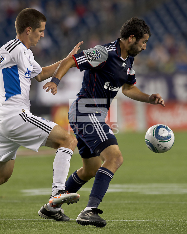 New England Revolution midfielder Monsef Zerka (19) controls the ball as San Jose Earthquakes midfielder Sam Cronin (4) pressures. In a Major League Soccer (MLS) match, the San Jose Earthquakes defeated the New England Revolution, 2-1, at Gillette Stadium on October 8, 2011.