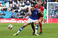 (L-R) Atdhe Nuhiu of Sheffield Wednesday challenged by Mike van der Hoorn of Swansea City during The Emirates FA Cup Fifth Round match between Sheffield Wednesday and Swansea City at Hillsborough, Sheffield, England, UK. Saturday 17 February 2018