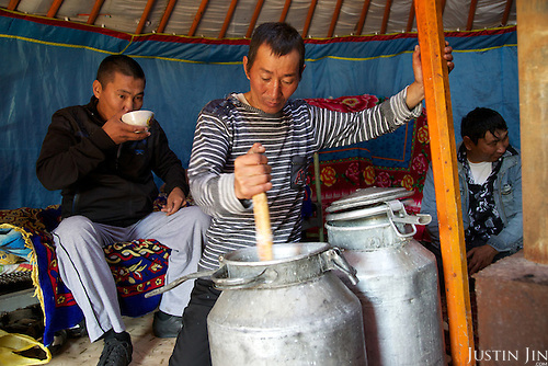 Orlan prepares an alcoholic drink by fermenting cow's milk on his 35th birthday inside his yurt in the taiga outside the Tuva Republic capital of Kyzyl in southern Siberia, Russia. Orlan (Tuvans normally use just one name) owns about 50 sheep, goats and milking cows. Like many other animal herders in the republic, Orlan prefers traditional farming methods but finds it difficult to compete in modern society. Alcoholism is rife in the region.