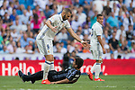 Karim Benzema of Real Madrid reacts as a young fan invades the pitch during the La Liga match between Real Madrid and Osasuna at the Santiago Bernabeu Stadium on 10 September 2016 in Madrid, Spain. Photo by Diego Gonzalez Souto / Power Sport Images