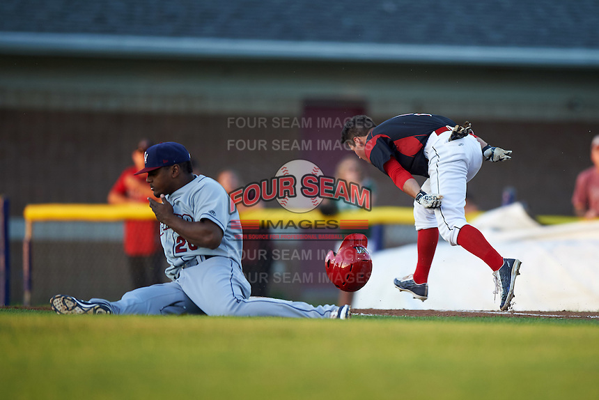 Mahoning Valley Scrappers first baseman Emmanuel Tapia (28) and base runner Aaron Knapp (5) collide during a game against the Batavia Muckdogs on August 18, 2016 at Dwyer Stadium in Batavia, New York.  Batavia defeated Mahoning Valley 2-1.  (Mike Janes/Four Seam Images)