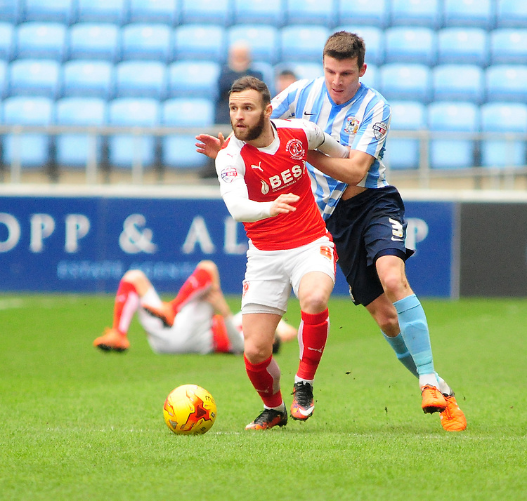 Fleetwood Town's Jimmy Ryan vies for possession with Coventry City's Chris Stokes<br /> <br /> Photographer Andrew Vaughan/CameraSport<br /> <br /> Football - The Football League Sky Bet League One - Coventry City v Fleetwood Town - Saturday 27th February 2016 - Ricoh Stadium - Coventry   <br /> <br /> &copy; CameraSport - 43 Linden Ave. Countesthorpe. Leicester. England. LE8 5PG - Tel: +44 (0) 116 277 4147 - admin@camerasport.com - www.camerasport.com