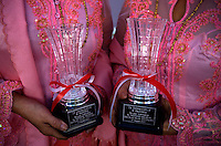 Rian and Rossy, the 'Twin Teachers', hold their awards for their contribution to education in Indonesia. Since the early 1990s, twin sisters Sri Rosyati (known as Rossy) and Sri Irianingsih (known as Rian) have used their family inheritance to set up and run 64 schools in different parts of Indonesia, providing primary education combined with practical skills to some of the country's most deprived children.