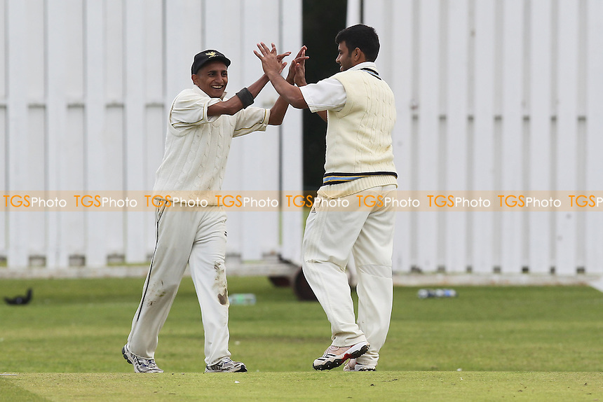 V Mane (R) of Gidea Park celebrates the wicket of J Edwards with M Bhad - Gidea Park & Romford CC vs Leigh-on-Sea CC - Essex Cricket League at Gallows Corner - 16/06/12 - MANDATORY CREDIT: Gavin Ellis/TGSPHOTO - Self billing applies where appropriate - 0845 094 6026 - contact@tgsphoto.co.uk - NO UNPAID USE.