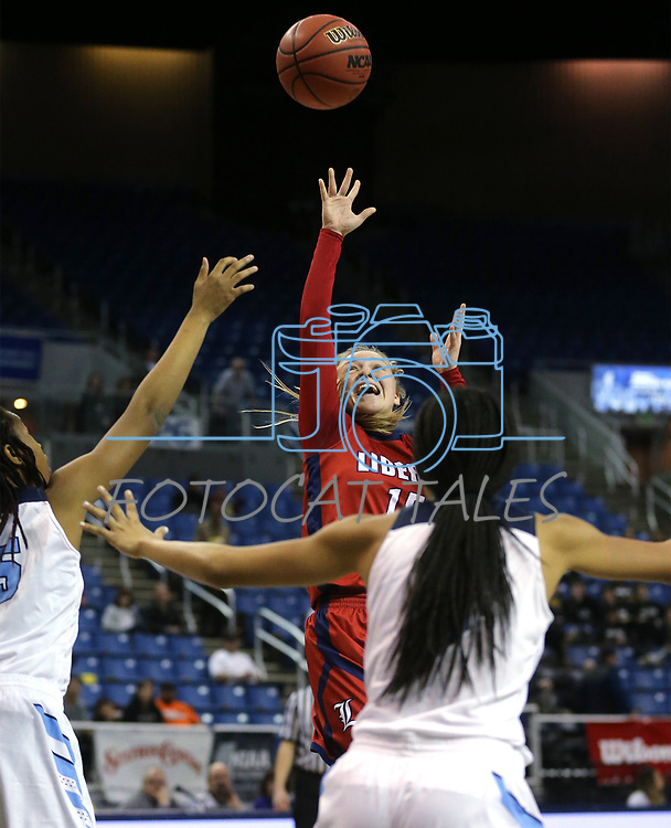 Liberty's London Pavlica shoots past Centennial defenders during the NIAA state basketball tournament in Reno, Nev., on Friday, Feb. 23, 2018. Centennial won the title, 74-65 in overtime. Cathleen Allison/Las Vegas Review-Journal