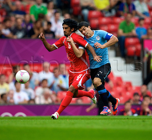 26.07.2012 Manchester, England. United Arab Emirates defender Hamdan Al Kamali and Uruguay forward Luis Suárez in action during the first round group A mens match between United Arab Emirates and Uruguay at Old Trafford.
