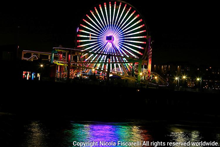 A night view of the Santa Monica Pier ferris wheel in Santa Monica California.