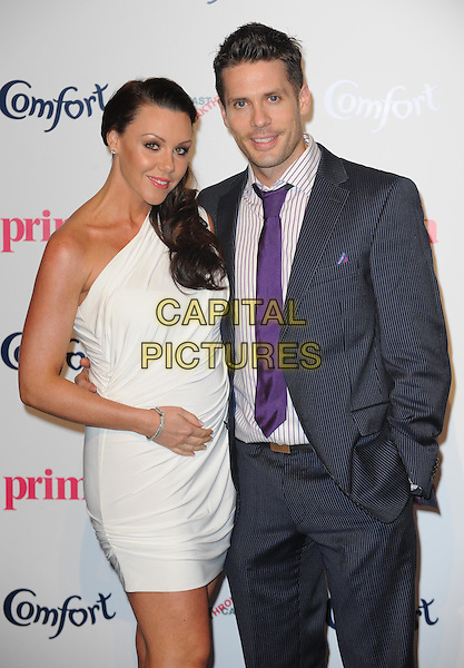 Michelle Heaton & Hugh Hanley.Prima High Street Fashion Awards, Battersea Evolutions, Battersea Park, London, England..September 8th, 2011.half length white one shoulder dress pregnant bracelet blue suit purple shirt tie couple .CAP/WIZ.© Wizard/Capital Pictures.