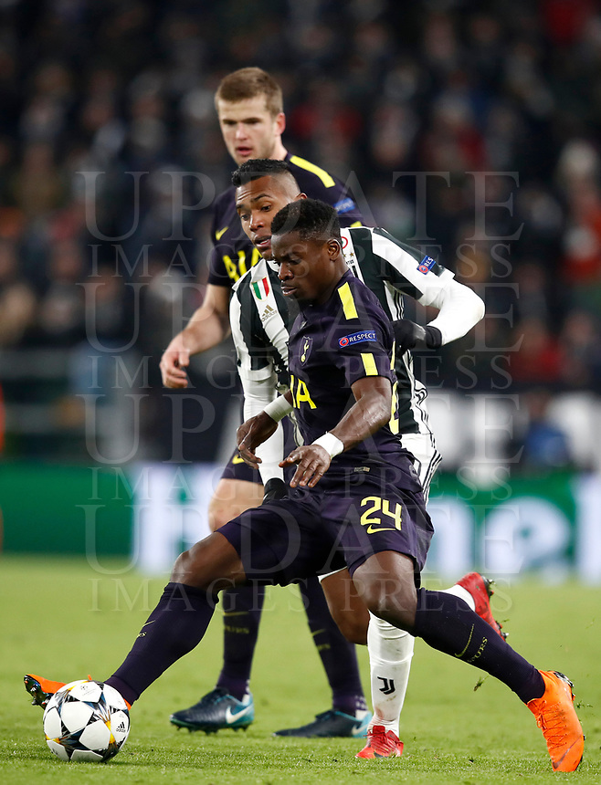 Football Soccer: UEFA Champions League Juventus vs Tottenahm Hotspurs FC Round of 16 1st leg, Allianz Stadium. Turin, Italy, February 13, 2018. <br /> Tottenham's Serge Aurier in action with Juventus' Alex Sandro (back) during the Uefa Champions League football soccer match between Juventus and Tottenahm Hotspurs FC at Allianz Stadium in Turin, February 13, 2018.<br /> UPDATE IMAGES PRESS/Isabella Bonotto