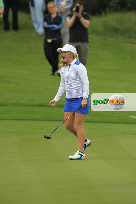 Bronte Law putts to win 2&amp;1 on the 17th green during the Friday morning Foursomes of the 2016 Curtis Cup at Dun Laoghaire Golf Club on Friday 10th June 2016.<br /> Picture:  Golffile | Thos Caffrey
