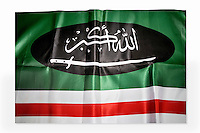 The flag of the Caucasian Front (Caucasian Mujahadeen), a paramilitary organisation in the Second Chechen War, is one of a number of items of clothing and objects found in an Islamic clothing and accessory shop in the Bagicilar district of Istanbul.