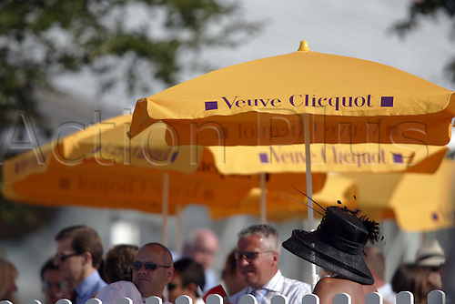 31 July 2004: Racegoers sheltering from the heat at Goodwood Photo: Glyn Kirk/Action Plus...horse racing 040731 hats fashion woman