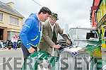 VINTAGE ENTHUSIASM:  Bill Smith from Kilgarvan explains the finer details of the engine of his 1952 Riley RMA to a visitor to the Kilgarvan Vintage Day and Traditional Music Festival.