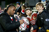 Samisoni Fisilau signs auotgraphs for fans after the game. ITM Cup rugby game between Counties Manukau and Manawatu played at Bayer Growers Stadium on Saturday August 21st 2010..Counties Manukau won 35 - 14 after leading 14 - 7 at halftime.