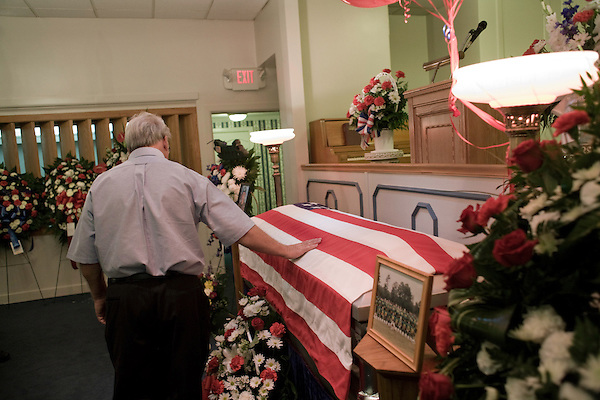 August 25, 2007. Kinston, NC.. A viewing of the coffin of Spc. Steven R. Jewell was held at Howard and Carter Funeral Home i Kinston, NC. Spc. Steven R. Jewell was killed in a helicopter crash  near the Iraqi city of Fallujah on August 14, 2007.. Jack Wisener, Spc. Jewell's stepfather, lays a hand on the coffin.