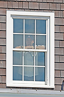 A fan watches out a window of the clubhouse during the third round of the 118th U.S. Open Championship at Shinnecock Hills Golf Club in Southampton, NY, USA. 16th June 2018.<br /> Picture: Golffile | Brian Spurlock<br /> <br /> <br /> All photo usage must carry mandatory copyright credit (&copy; Golffile | Brian Spurlock)
