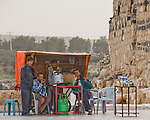 """Snack Shop"" -- Four local men relax at the only refreshment stand outside the ruins of Gadara, at Umm Qais, northwestern Jordan.  © Rick Collier"