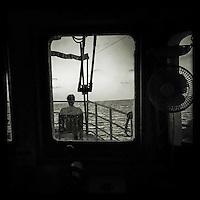 Sea Watch-2.<br /> Die Sea Watch-2 bei ihrer 13. SAR-Mission vor der libyschen Kueste.<br /> Im Bild: Ein Crewmitglied sitz auf dem Brueckendeck.<br /> 20.10.2016, Mediterranean Sea<br /> Copyright: Christian-Ditsch.de<br /> [Inhaltsveraendernde Manipulation des Fotos nur nach ausdruecklicher Genehmigung des Fotografen. Vereinbarungen ueber Abtretung von Persoenlichkeitsrechten/Model Release der abgebildeten Person/Personen liegen nicht vor. NO MODEL RELEASE! Nur fuer Redaktionelle Zwecke. Don't publish without copyright Christian-Ditsch.de, Veroeffentlichung nur mit Fotografennennung, sowie gegen Honorar, MwSt. und Beleg. Konto: I N G - D i B a, IBAN DE58500105175400192269, BIC INGDDEFFXXX, Kontakt: post@christian-ditsch.de<br /> Bei der Bearbeitung der Dateiinformationen darf die Urheberkennzeichnung in den EXIF- und  IPTC-Daten nicht entfernt werden, diese sind in digitalen Medien nach &sect;95c UrhG rechtlich geschuetzt. Der Urhebervermerk wird gemaess &sect;13 UrhG verlangt.]