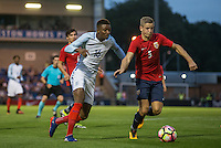 Demarai Gray (Leicester City) of England takes on Thomas Grogaard (Odd) of Norway during the International EURO U21 QUALIFYING - GROUP 9 match between England U21 and Norway U21 at the Weston Homes Community Stadium, Colchester, England on 6 September 2016. Photo by Andy Rowland / PRiME Media Images.