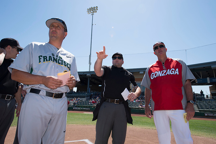 May 23, 2013; Stockton, CA, USA; Home plate umpire Scott Letendre (center) talks to San Francisco Dons head coach Nino Giarratano (left) and Gonzaga Bulldogs head coach Mark Machtolf (right) during the WCC Baseball Championship at Banner Island Ballpark.
