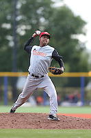 Nathanael Santiago (18) of the Salem-Keizer Volcanoes pitches during a game against the Hillsboro Hops at Ron Tonkin Field on July 26, 2015 in Hillsboro, Oregon. Hillsboro defeated Salem-Keizer, 4-3. (Larry Goren/Four Seam Images)