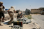 Canadian soldiers with the Royal 22nd Regiment fire mortars at Taliban fighters shelling their outpost near the village of Belanday in Kandahar province, Afghanistan. The soldiers say they trade mortar fire almost daily with Taliban fighters operating in the area.  Aug. 5, 2009 DREW BROWN/STARS AND STRIPES