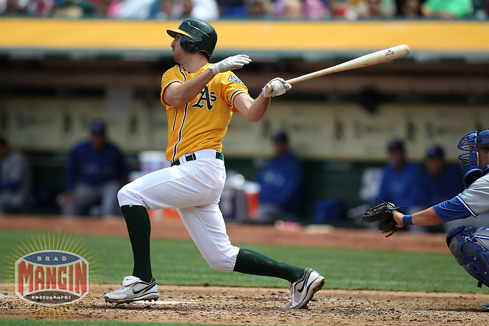 OAKLAND, CA - AUGUST 4:  Adam Rosales #17 of the Oakland Athletics bats against the Toronto Blue Jays during the game at O.co Coliseum on Saturday, August 4, 2012 in Oakland, California. Photo by Brad Mangin
