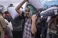 NEW YORK CITY, NY - APRIL 2 : A woman takes part during the International pillow fight event in Washington Square Park on April 2, 2016 in New York City, NewYork. Thousands of people of all ages attend the free global event celebrating the 11th annual International Pillow Fight.  Photo by VIEWpress/Maite H. Mateo