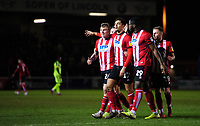 Lincoln City's Tyler Walker, centre, celebrates scoring his side's second goal with team-mates Harry Anderson, left, and John Akinde<br /> <br /> Photographer Chris Vaughan/CameraSport<br /> <br /> The EFL Sky Bet League One - Lincoln City v Bolton Wanderers - Tuesday 14th January 2020  - LNER Stadium - Lincoln<br /> <br /> World Copyright © 2020 CameraSport. All rights reserved. 43 Linden Ave. Countesthorpe. Leicester. England. LE8 5PG - Tel: +44 (0) 116 277 4147 - admin@camerasport.com - www.camerasport.com