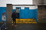 Port Talbot Town 3 Caerau Ely 0, 06/02/2016. Genquip Stadium, Welsh Cup fourth round. Spectators making their way towards the turnstiles before Port Talbot Town played host to Caerau Ely in a Welsh Cup fourth round tie at the Genquip Stadium, formerly known as Victoria Road. Formed by exiled Scots in 1901 as Port Talbot Athletic, they competed in local and regional football before being promoted to the League of Wales  in 2000 and changing their name to the current version a year later. Town won this tie 3-0 against their opponents from the Welsh League, one level below the welsh Premier League where Port Talbot competed, watched by a crowd of 113. Photo by Colin McPherson.