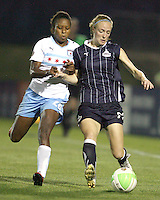Becky Sauerbrunn #22 of the Washington Freedom blocks Jessica McDonald #22 of the Chicago Red Stars during a WPS match at Maryland Soccerplex on August 19 2010, in Boyds, Maryland. Freedom won 2-0.
