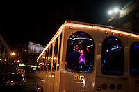People dance and drink in The Original Party Trolley of Boston outside Fenway Park on the night before the 2011 Red Sox season opener in Boston, Massachusetts, USA.