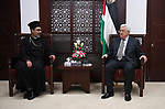 Palestinian President Mahmoud Abbas meets with a head of Zababida municipality, at his office in the West Bank city of Ramallah on June 27, 2017. Photo by Osama Falah
