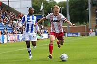 Alex Samuel of Stevenage and Kyel Reid of Colchester United during Colchester United vs Stevenage, Sky Bet EFL League 2 Football at the Weston Homes Community Stadium on 12th August 2017