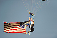Skydiver Jim Burris of the Flying Tigers Sport Parachute Center in Anderson drops in at Fluor Field on Greenville Drive's Military Appreciation Night July 1, 2014, prior to a game against the Asheville Tourists.