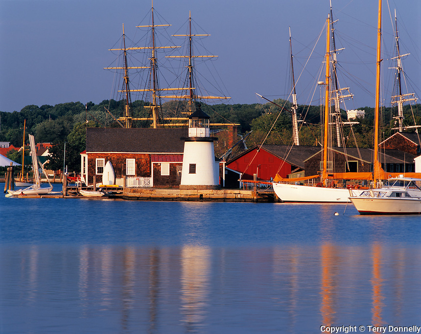 Mystic, CT: View across the Mystic River to the lighthouse and ships of Mystic Seaport