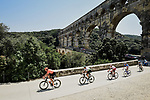 The breakaway featuring Lukasz Wisniowski (POL) CCC Team, Lars Ytting Bak (DEN) Dimension Data, Stephane Rossetto (FRA) Cofidis, Paul Ourselin (FRA) Total Direct Energie and Alexis Gougeard (FRA) AG2R La Mondiale pass beneath Pont du Gard during Stage 16 of the 2019 Tour de France running 177km from Nimes to Nimes, France. 23rd July 2019.<br /> Picture: ASO/Pauline Ballet | Cyclefile<br /> All photos usage must carry mandatory copyright credit (© Cyclefile | ASO/Pauline Ballet)