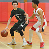 Shane Wagner #2 of Harborfields, left, gets pressured by Joshua Serrano #1 of Amityville during a Suffolk County varsity boys basketball game at Amityville High School on Thursday, Jan. 12, 2017. Harborfields won by a score of 81-41.