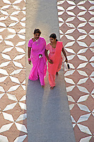 Visiting the The Taj Mahal in Agra,India Women in their traditional colorful dress craeting a spectacle in design and color in contarst to the white Marble of the Taj