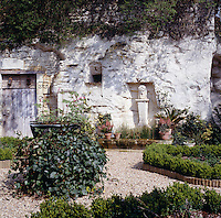 New flower beds have been created in the central gravel courtyard and a fountain hewn out of the rock by a local sculptor