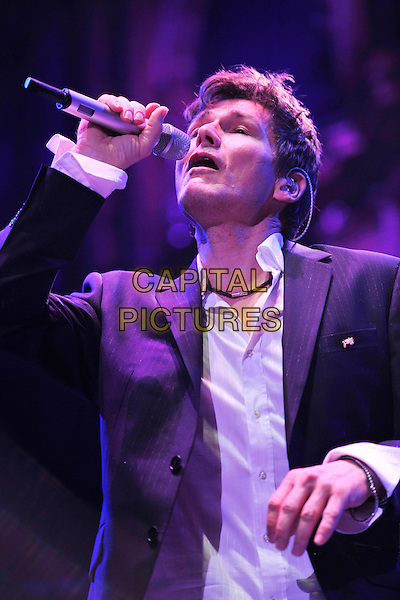 A-HA - MORTEN HARKET .Live at the Royal Albert Hall, London, England, UK, October 8th 2010..music concert gig half length microphone  signing .CAP/MAR.© Martin Harris/Capital Pictures.
