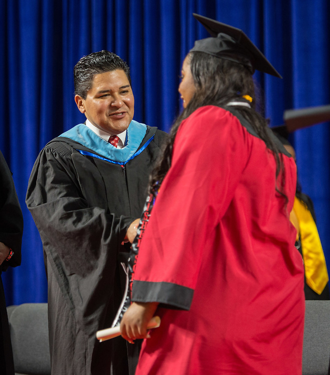 Houston ISD Superintendent Richard Carranza congratulates tudents during the Furr / Reach High School graduation in Delmar Fieldhouse, May 26, 2017. The ceremony was the first graduation to be held in the newly constructed facility.