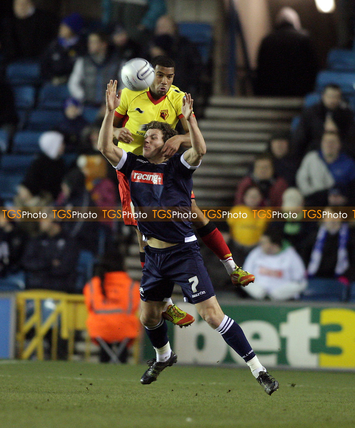 Darius Henderson of Millwall FC is held by Adrian Mariappa of Watford FC - Millwall vs Watford - nPower Championship Football at the New Den, London - 31/01/12 - MANDATORY CREDIT: Helen Watson/TGSPHOTO - Self billing applies where appropriate - 0845 094 6026 - contact@tgsphoto.co.uk - NO UNPAID USE.