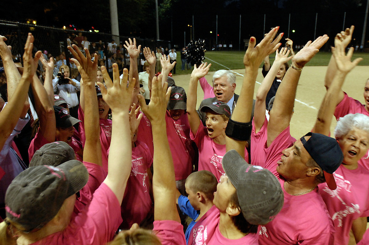 Members of the House and Senate congressional softball team do a team cheer to boost their spirits at Guy Mason Field on Tuesday Night. Tuesday, July 14, 2009.