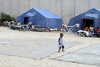 Roma, 12 Agosto 2015<br /> Tendopoli allestita dalla Croce Rossa nei pressi della stazione ferroviaria Tiburtina per migranti. Centinaia di migranti provenienti da Etiopia, Somalia ed Eritrea, tutti arrivati negli ultimi mesi dalla Libia con i barconi e portati in Italia dopo essere stati salvati in mare.<br /> Bambini<br /> Camp set-up by the Red Cross close to the Tiburtina train station for migrants. Hundreds of migrants mainly from Ethiopia, Somalia and Eritrea, all arrived in recent months from Libya with the barges and taken to Italy after being rescued at sea.