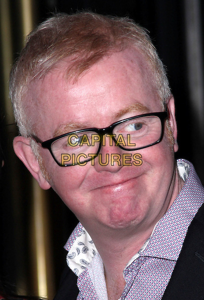 CHRIS EVANS .The TRIC Awards 2010 (Television and Radio Industries Club) held at the Grosvenor House hotel, Park Lane, London, England, UK, March 9th 2010.outside arrivals portrait headshot glasses red pink blue print shirt collar .CAP/JIL.©Jill Mayhew/Capital Pictures.